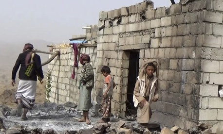 In this Feb. 3, 2017 frame grab from video, residents inspect a house that was damaged during a Jan. 29, 2017 US raid on the tiny village of Yakla, in central Yemen.