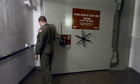 In this photo taken June 24, 2014, 1st Lt. Phil Parentrau opens the first of two blast doors leading to the underground control room at an ICBM launch control facility near Minot, N.D.