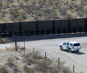 A Border Patrol vehicle secures border fence line in Arizona in 2011.