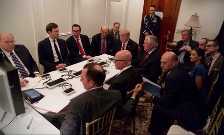 U.S. President Donald Trump is shown in an official White House handout image meeting with his National Security team at his resort in Mar-a-Lago, on April 6.