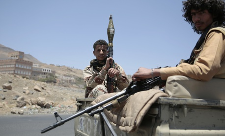Shiite fighters, known as Houthis, secure a road from Sanaa to the port city of Hodeidah, Yemen, Wednesday, Apr. 19, 2017.