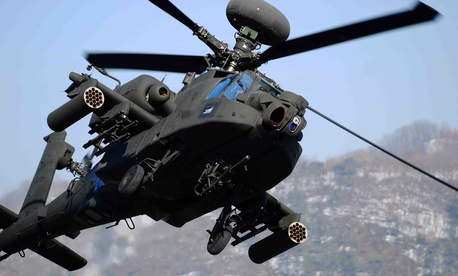 Lawmakers added one-quarter of the extra Apache attack helicopter requested by the Trump administration.