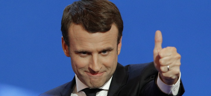 French centrist presidential candidate Emmanuel Macron thumbs up as he addresses his supporters at his election day headquarters in Paris , Sunday April 23, 2017.