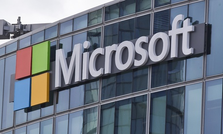 "This April 12, 2016 file photo shows the Microsoft logo in Issy-les-Moulineaux, outside Paris, France. The cyberextortion attack hitting dozens of countries was a ""perfect storm"" of sorts."