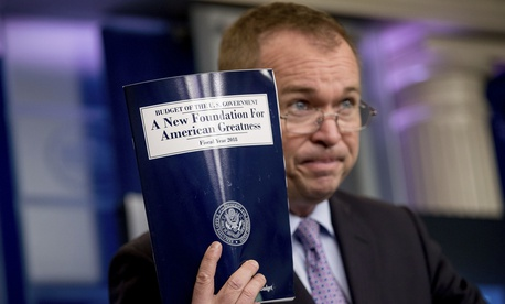 Budget Director Mick Mulvaney holds up a copy of President Donald Trump's proposed fiscal 2018 federal budget as he speaks to members of the media in the Press Briefing Room of the White House in Washington, Tuesday, May 23, 2017.