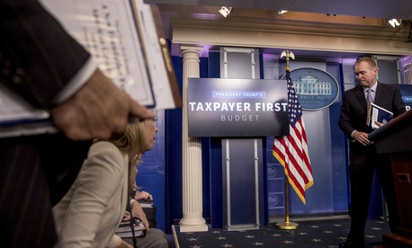 Budget Director Mick Mulvaney departs after speaking to the media about President Donald Trump's proposed fiscal 2018 federal budget in the Press Briefing Room of the White House, May 23, 2017.