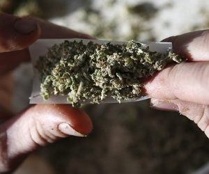 Medical marijuana for a veteran U.S. Marine is rolled into a joint in Belfast, Maine, Nov. 21, 2014.