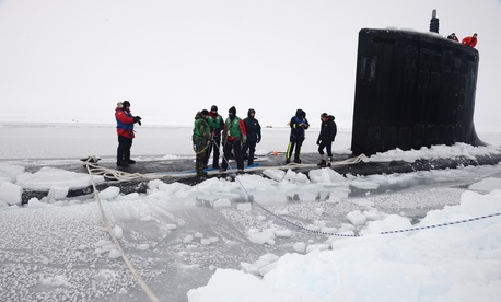 Sailors aboard USS New Mexico tie mooring lines after the submarine surfaced through the arctic ice at Ice Camp Nautilus, north of Alaska, in 2014.