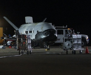 The U.S. Air Force X-37B, named Orbital Test Vehicle 1 (OTV-1), sits on the Vandenberg Air Force Base, Calif., runway during post-landing operations Dec. 3, 2010.