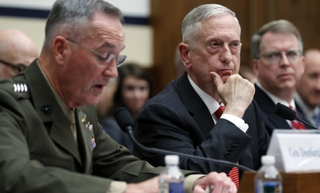 Joint Chiefs Chairman Gen. Joseph Dunford, left, speaks as Defense Secretary Jim Mattis, and Defense Under Secretary and Chief Financial Office David Norquist, listen during a House Armed Services Committee hearing on the FY'18 defense budget.