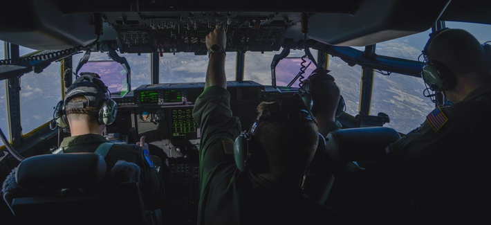 An Airman flips a switch during the first Yokota C-130J Super Hercules training sortie over the skies of Japan March 20, 2017.