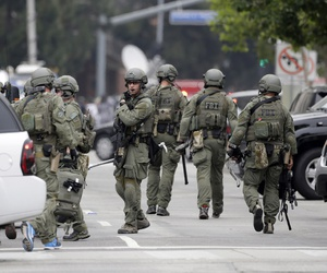 An FBI SWAT team arrives at the scene of a fatal shooting at the University of California, Los Angeles, Wednesday, June 1, 2016, in Los Angeles