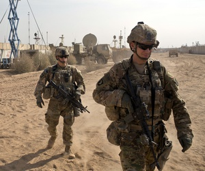 U.S. Army soldiers move through Qayara West Coalition base in Qayara, some 50 kilometers south of Mosul, Iraq.