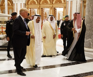 President Donald Trump and Saudi King Salman, center left, arrive to the Arab Islamic American Summit, at the King Abdulaziz Conference Center, Sunday, May 21, 2017, in Riyadh, Saudi Arabia.
