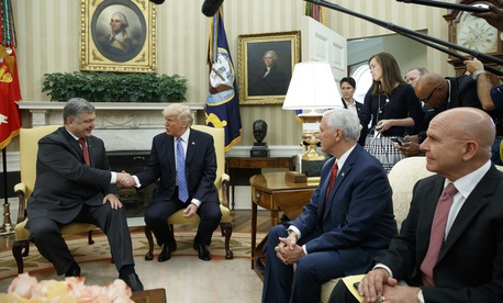 President Donald Trump shakes hands with Ukrainian President Petro Poroshenko during a meeting in the Oval Office of the White House, Tuesday, June 20, 2017, in Washington. From left, Poroshenko, Trump, Vice President Mike Pence, and H.R. McMaster.