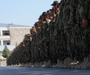 Afghan National Army recruits stand in formation during their graduation ceremony at the Kabul Military Training Center Sept. 22, 2011