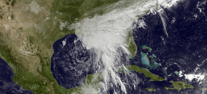 This satellite image taken Tuesday, June 20, 2017, and released by the National Oceanic and Atmospheric Administration shows a tropical storm over the Gulf of Mexico approaching the Gulf Coast.