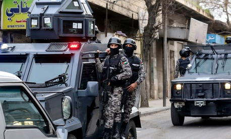 """Jordanian intelligence services work closely with the country's security forces, as in this March 2016 raid in downtown Irbid, which targeted extremists planning attacks on military and civilian targets."""