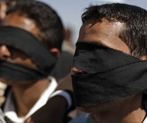 Protesters wear blindfolds to symbolize torture that they claim security forces commit against detained protesters during a demonstration demanding the prosecution of Yemen's President Ali Abdullah Saleh in Sanaa, Yemen, Friday, Dec. 30, 2011.