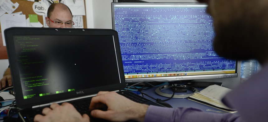 n this picture taken on March 5, 2015, employees work at the headquarters of Bitdefender, a leading Romanian cyber security company, in Bucharest, Romania. Romania, the eastern European country, known more for economic disarray than technological prowess.