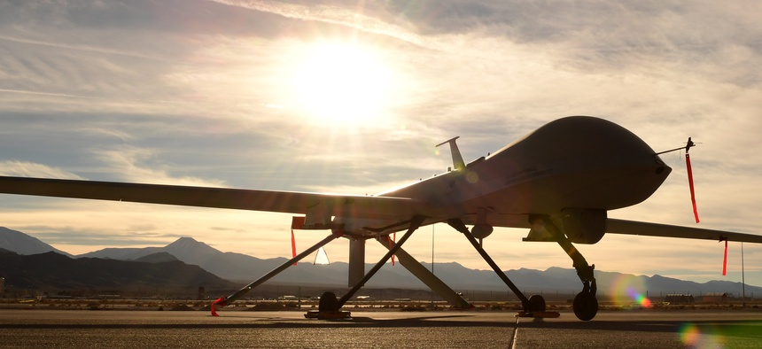 An MQ-1 Predator sits on the flight line. The predator started as an RQ-1 in the late 1990s providing reconnaissance until the early 2000s when it was equipped with two Hellfire missiles.