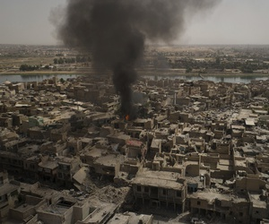 Smoke billows over the Old City after a strike as Iraqi forces continue their advance against Islamic State militants in Mosul, Iraq, Monday, July 3, 2017.