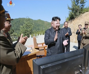 North Korea leader Kim Jung Un, center, applauding after the launch of a Hwasong-14 intercontinental ballistic missile, ICBM, in North Korea's northwest, July 4, 2017.