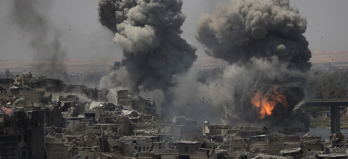 """Airstrikes target Islamic State positions on the edge of the Old City a day after Iraq's prime minister declared """"total victory"""" in Mosul, Iraq, Tuesday, July 11, 2017"""
