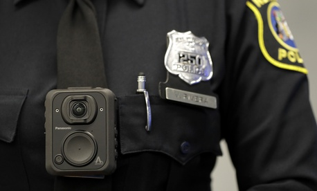 Newark police officer Veronica Rivera displays how a body cam is worn during a news conference unveiling the department's new cameras at the Panasonic headquarters , Wednesday, April 26, 2017, in Newark, N.J.