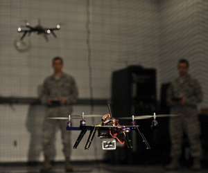 U.S. Air Force Capt. Wilfred Noel, deputy chief of the Air Force Research Lab, left, and 1st Lt. Jason Rathje, an advanced weapon design engineer with Air Force Research Lab weapons dynamics and control science branch, right, pilot quadrotor vehicles.