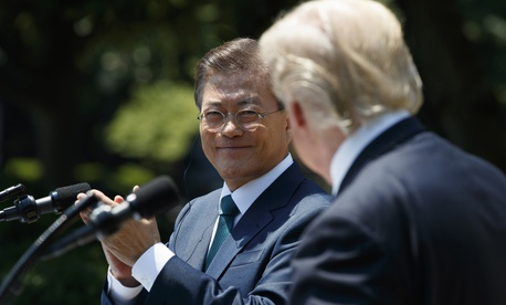 South Korean President Moon Jae-in applauds President Donald Trump after he made a statement in the Rose Garden of the White House in Washington, Friday, June 30, 2017.
