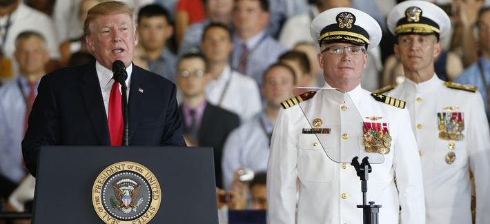 President Donald Trump, left, puts the USS Gerald Ford into commission as Ships commander Capt. Richard McCormack, front right, listens aboard the nuclear aircraft carrier USS Gerald R. Ford for it's commissioning at Naval Station Norfolk in Norfolk, Va.,