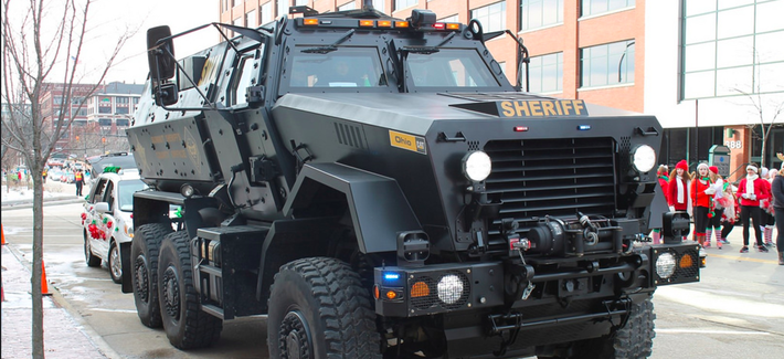 The Pentagon's 1033 program has distributed billions of dollars worth of weapons, gear, and vehicles like this BAE Systems Caiman MRAP to the Summit County, Ohio, Sheriff's Department.