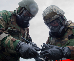 KADENA AIR BASE, Japan (Feb. 9, 2017) - U.S. Air Force Senior Airman Adam Reams and Airman 1st Class Daniel Paolucci, 18th Communications Squadron client systems technicians, conduct a post-attack reconnaissance stand check during Exercise Green Dragon at