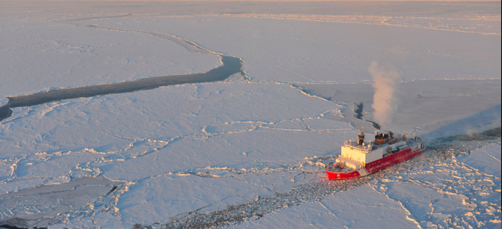 The Kigluaik Mountains are visible as the Coast Guard Cutter Healy breaks ice for the Russian tanker Renda near Nome Jan. 13, 2012.