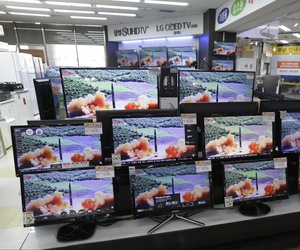 TV screens in an electronics shop display a news program's report on North Korea's missile firing in Seoul, South Korea, Thursday, July 6, 2017.