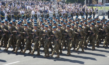 Ukrainian army soldiers march on Khreshchatyk street during military parade on the occasion of Ukraine's Independence Day in the capital Kiev, Ukraine, Monday, Aug. 24, 2015.