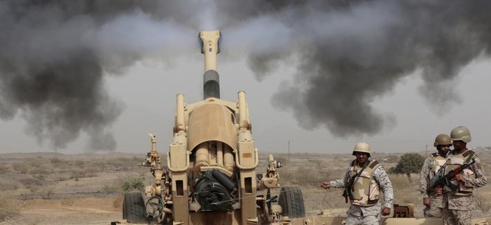 Saudi soldiers fire artillery toward three armed vehicles approaching the Saudi border with Yemen in Jazan, Saudi Arabia, on April 20, 2015.