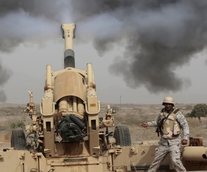 Saudi soldiers fire artillery toward three armed vehicles approaching the Saudi border with Yemen in Jazan, Saudi Arabia, on April 20, 2015.