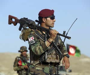 Afghan National Army soldiers stand guard at a checkpoint on the outskirts of Kabul, Afghanistan, Monday, Aug. 21, 2017. Deep in the mountains of eastern Afghanistan, on the front lines against Taliban and Islamic State fighters.