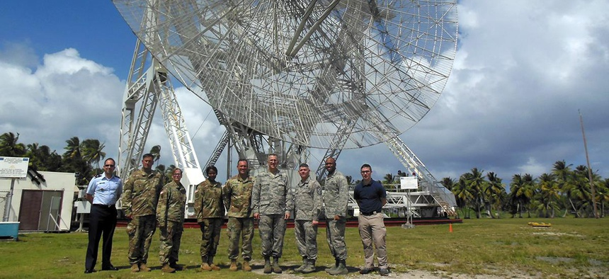 United States Strategic Command commander Air Force Gen. John Hyten, fourth from right, visits SMDC's Reagan Test Site on Kwaj.
