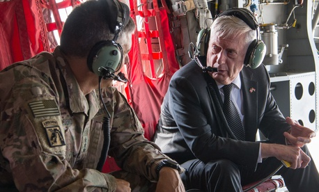 Secretary of Defense Jim Mattis talks with U.S. Army Lt. Gen. Stephen Townsend, the commander of Combined Joint Task Force Operation Inherent Resolve, during a flight in Baghdad, Iraq, Aug. 22, 2017.