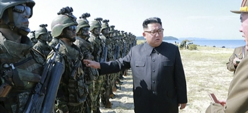 """This image made from video aired by North Korea's KRT on Saturday, Aug. 26, 2017 shows a photo of North Korean leader Kim Jong Un inspecting soldiers during what Korean Central News Agency called a """"target=striking contest"""" in North Korea."""