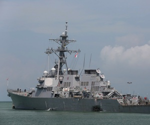 The Guided-missile destroyer USS John S. McCain (DDG 56) is moored pier side at Changi naval base in Singapore following a collision with the merchant vessel Alnic MC Monday, Aug. 21, 2017.