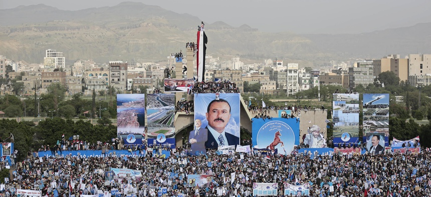 Supporters of former Yemeni President Ali Abdullah Saleh attend a ceremony to celebrate the 35th anniversary of the founding of the Popular Conference Party, in Sanaa, Yemen, Thursday, Aug. 24, 2017.