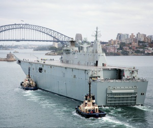In this 2014 photo, the Royal Australian Navy's Landing Helicopter Dock Canberra passes through Sydney Heads for the first time.