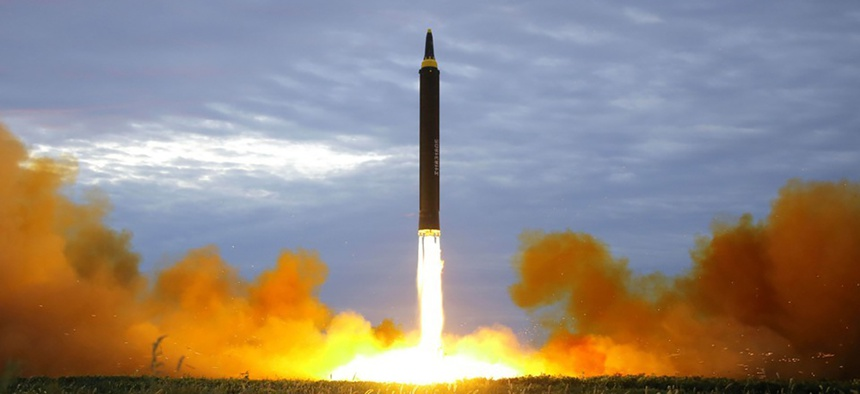 A missile is launched during a long and medium-range ballistic rocket launch drill in this photo released by North Korea's Korean Central News Agency in Pyongyang on August 30, 2017.