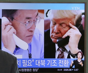 A man watches a television screen showing U.S. President Donald Trump, right, and South Korean President Moon Jae-in during a news program at the Seoul Railway Station in Seoul, South Korea, Tuesday, Sept. 5, 2017.
