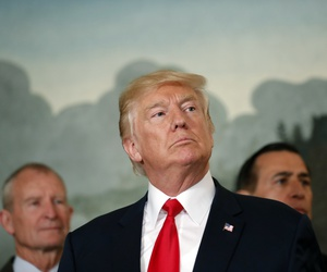 President Donald Trump pauses to answer a question after an event to sign a memorandum calling for a trade investigation of China, Aug. 14, 2017.