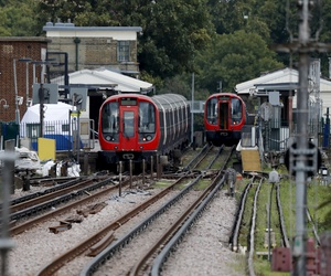 A police forensic tent stands setup on the platform next to the train, at left, on which a homemade bomb exploded at Parsons Green subway station in London, Friday, Sept. 15, 2017.
